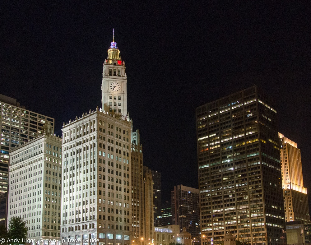 Wrigley building at night from boat