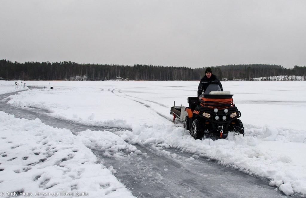 Snowmobile on frozen lake