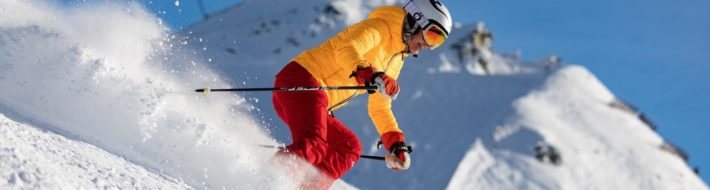 person-in-yellow-jacket-and-red-pants-skiing-3800412